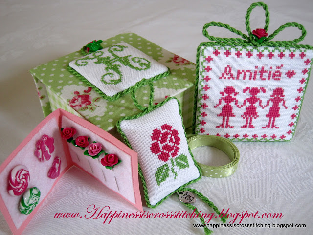 Cross stitched covered box with matching pin keep, pillow and polymer clay roses.