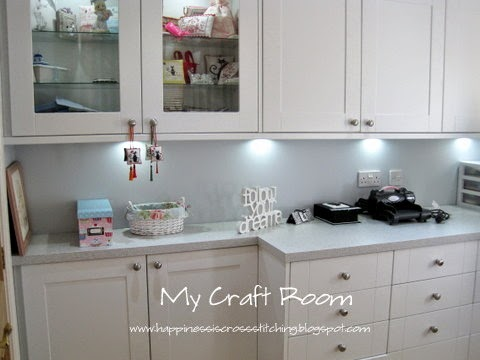 My craft room includes lots of cupboard space for my cross stitching and crafting, white cupboards and pale grey work surfaces compliment each other.