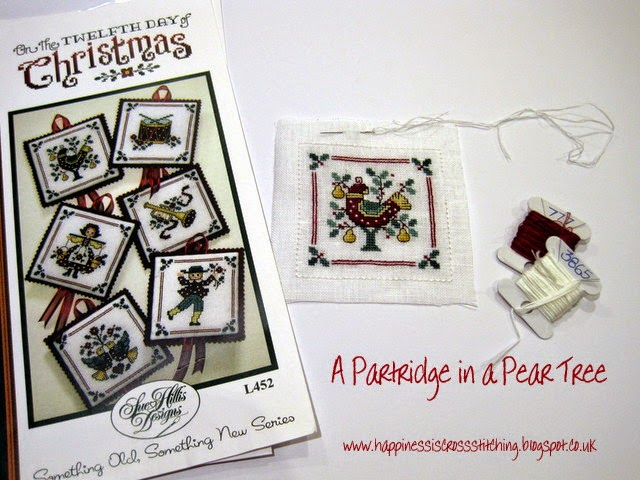 A Partridge in a Pear Tree cross stitched ornament