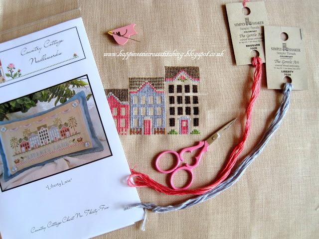 Cross stitching, a new shawl and an award!