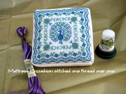 Cross stitched Peacock Mattress Pincushion has arrived.