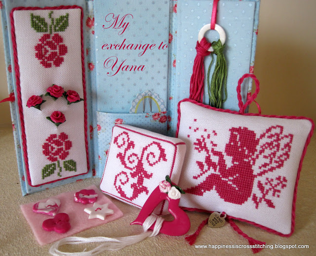 Cross stitched gift set featuring a Toblerone shaped needle case with matching mattress pincushion and pillow with angel cross stitched in pink with rose details.