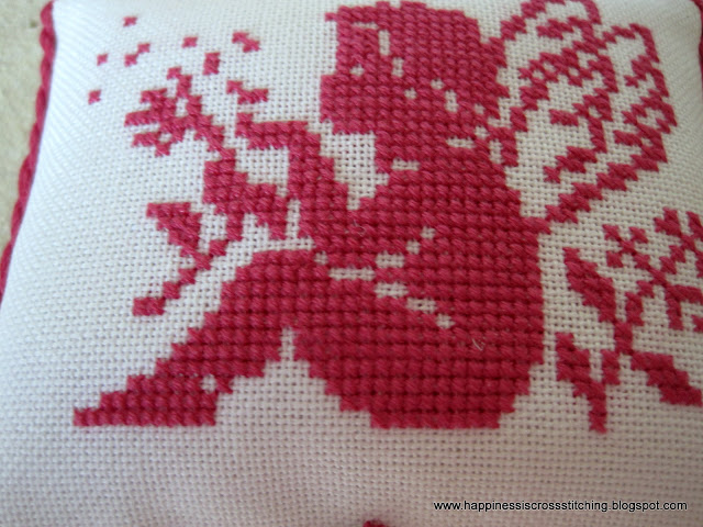 Angel cross stitched pillow