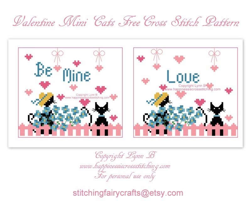 Valentine's cross stitch pattern showing two mini black cats sitting in the garden by a pink picket fence.There are blue flowers growing by the fence and pink hearts floating in the air.