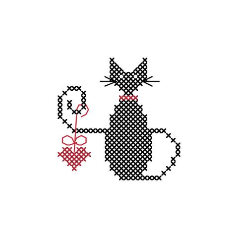 Black cat cross stitch pattern of cat holding a red heart