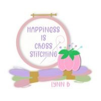 Happiness is cross stitching logo for website featuring a skein of thread, embroidery hoop and pin cushion