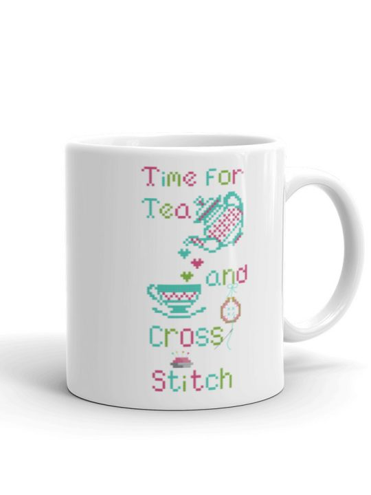 Tea mug with Love tea and cross stitch design, includes a teapot, teacup and embroidery hoop with needle and thread