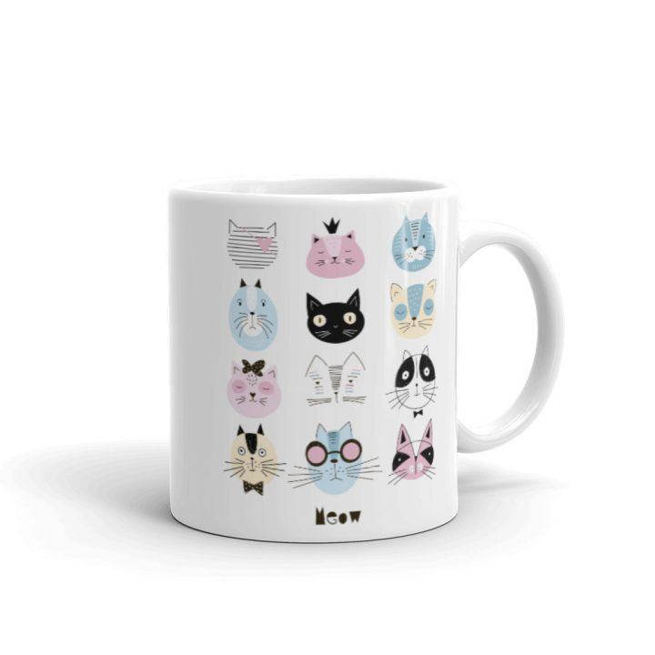 Cat face coffee mug featuring various cat faces to make you smile.