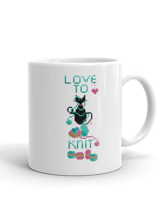 Love to knit coffee mug featuring a black cat tangled up in balls of yarn.